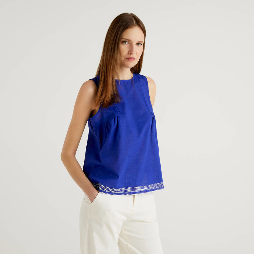 Sleeveless top with embroidered bottom